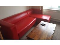 Red leather corner sofa, can deliver locally.