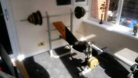 Weight bench and 58.4kg of weights