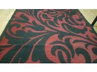 V big beautiful modern stylish red and black low pile rug