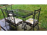 wrought iron and glass table and 4 chairs