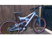 girl and boy mountain bikes in good working order 24 inch wheels see photos