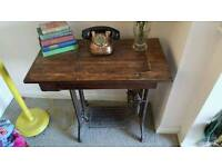 Vintage Singer sewing machine on table, foot pedal operated, antique