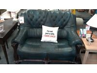 Blue leather sofa with chesterfield detail
