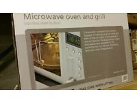 Brand New Caple CM116 stainless steel integrated tower microwave oven and grill.