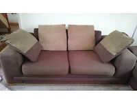 Two identical, brown fabric, two seater sofas for sale