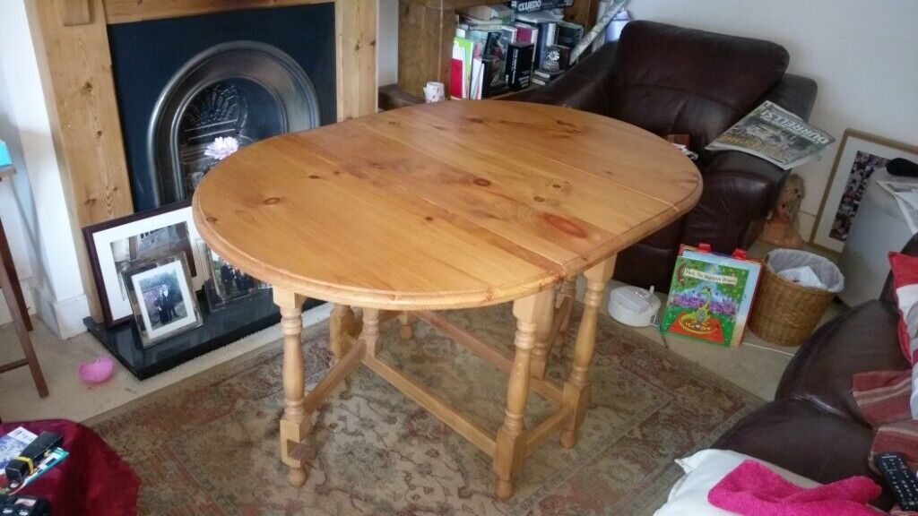 oval pine drop leaf 46 seat dining room table  in