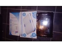 boxed wii sports package, wii fit, black console, controls, nun chucks, games etc