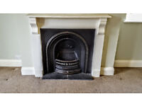 Victorian Cast iron arch fireplace with simple painted wood fire surround in good condition