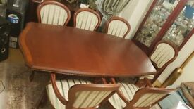 Excellent condition dining table and 6 chairs Expandable table up to 8 Solid wood Looks brand new.