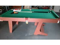 Pool Table. Portable . Complete with 2 pool cues and balls.