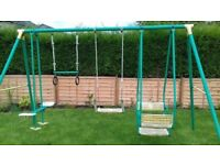 Swing Set in good condition, money bar/ring, single seat swing, and 2 different style double swings