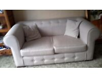 Cream two seater sofa bed in excellent condition 6 months old