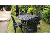 Large cast alloy garden table and chairs