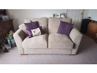 TWO SEAT SOFA AND CHAIR.... Barely been sat on, Mint condition!! (purple cushions are not included)