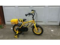 "Child's yellow bicycle with stabilisers 12"" wheels"