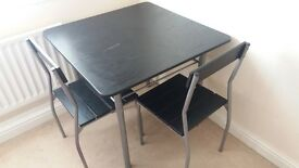 Black and silver dining/ kitchen table with 4 chairs