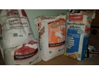 Free - Partly used bags of wall adhesive and finisher