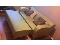 two seater green leather sofa with chrome legs and matching double footstool