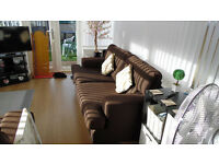 3-SEATER SETTEE AND MATCHING CHAIR IN CHOCOLATE BROWN FABRIC. EXCELLENT CONDITION.