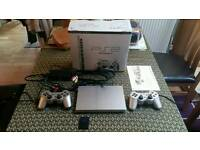 Sony PS2 Silver Slim fully boxed.