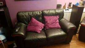 Black leather sofa 3 + 2 seater suite with red accents