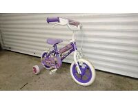 "Girls bike with 12"" wheels and removable stabilisers"
