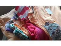 Job lot of ladies tops jeans and trousers.