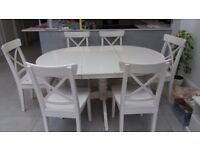 Ikea white extendable dining table and six chairs