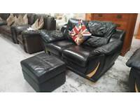 Black leather 2 x 2 seater sofa & pouffee can deliver 07808222995