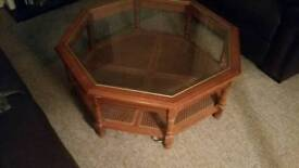 Octagonal wood and glass coffee table