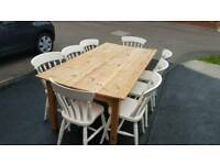 LARGE PINE TABLE AND CHAIRS SEATS 8. IDEAL FOR A LARGE XMAS GATHERING