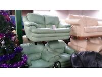 Green leather 2 seater and 2 arm chairs