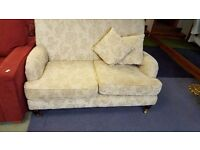 Vintage 2 seater fabric sofa with castors in Great condition