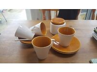Vintage set of four cups and saucers with sugar bowl