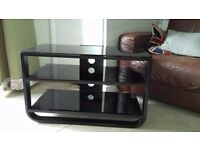 Metal and glass TV cabinet.