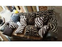 Zebra print two seater sofa x2