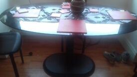 Glass and iron leg dinning room table and chairs