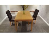 Excellent condition wooden dining room table for sale
