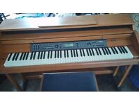 Electric piano for sale in teak finish comes with matching stool and manual excellent condition