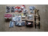 Assorted latches, hinges, handles for doors