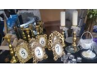 Beautiful wedding accessories. Mirror plates, candle holders, rose garlands,tea light holders,