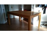 Solid Oak dining table and 4 brown leather chairs