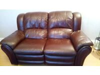 brown leather electric recliner settee. both seats recline excellent condition