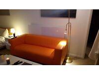 Orange IKEA Klippan Leather Sofa like new