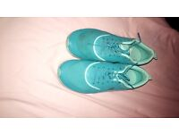 Teal blue Nike theas women trainers in UK size 6.