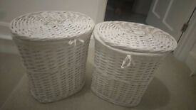 Two white wicker washing baskets