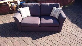 Dark grey, two seater sofa bed in very good condition.