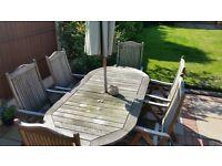 Pagoda patio table and chairs, hard wood.