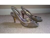 Ladies mid heel bronze metallic size 6 shoe.
