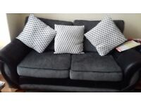 A lovely two seater and big arm chair